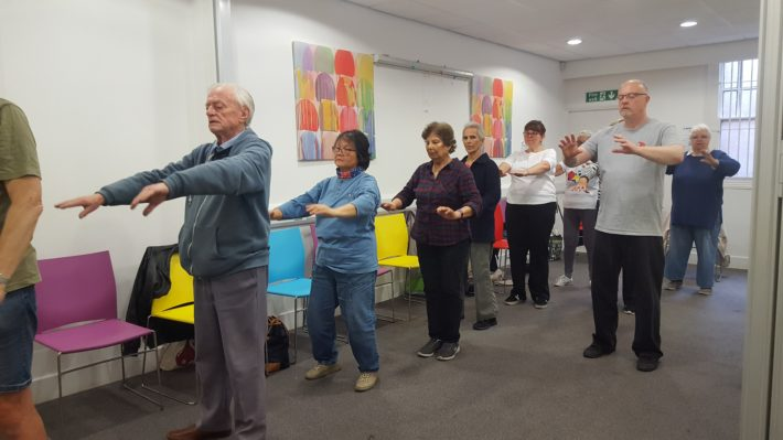 Carers doing Tai Chi moves