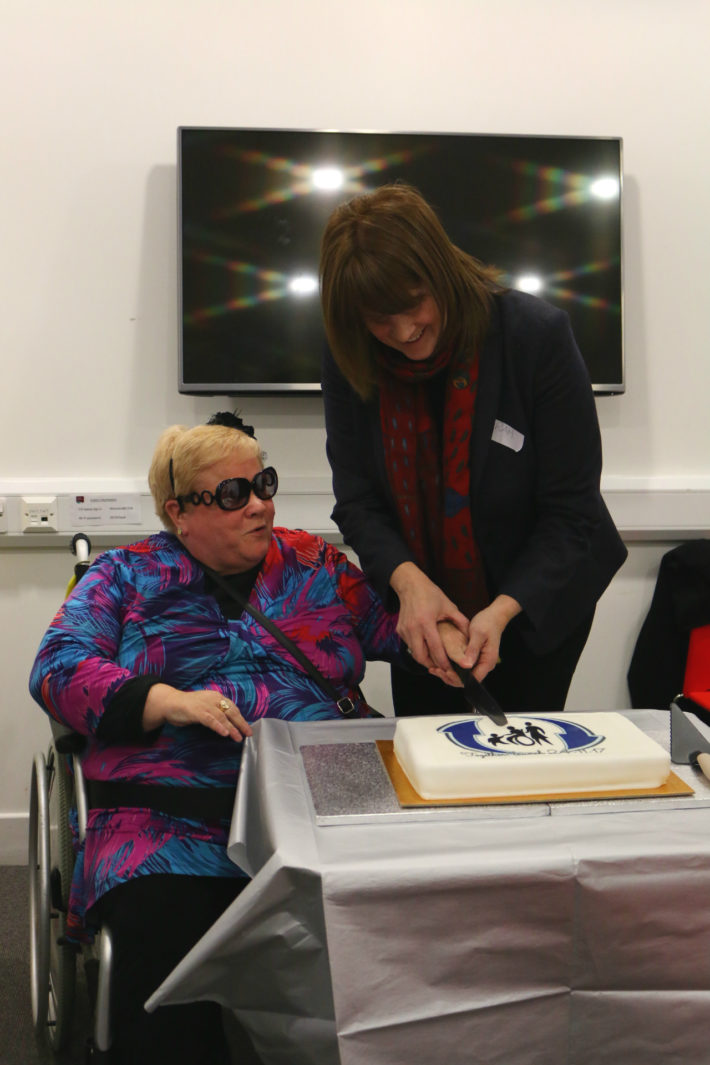 Sarah Jones MP cutting the launch cake with Mandy Maddock