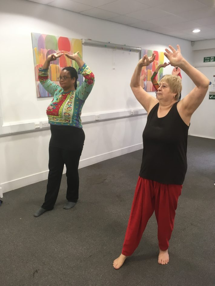 two carers dancing