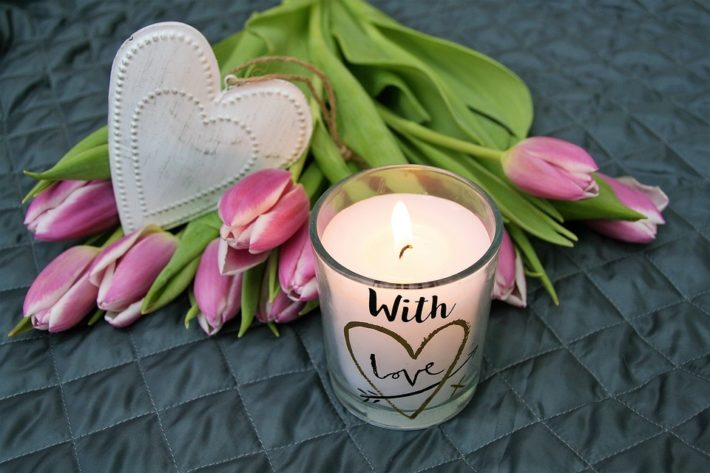 flowers, heart and candle in memory