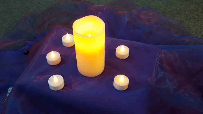 candle on purple table