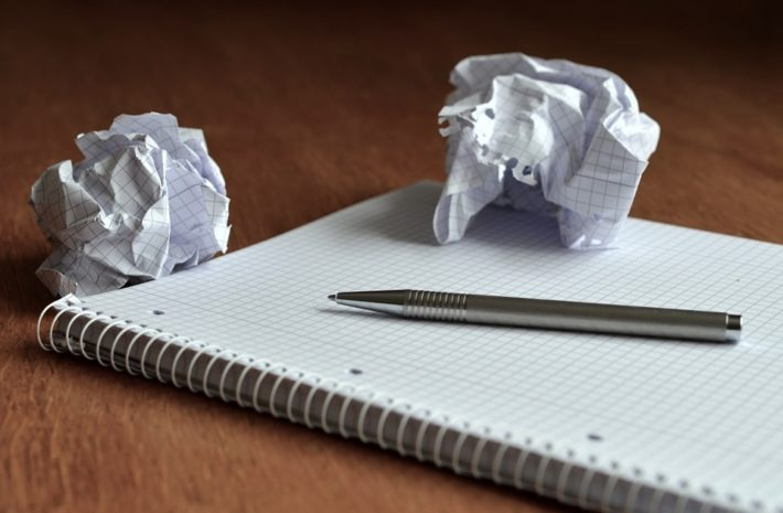 notepad with pen and scrunched up paper
