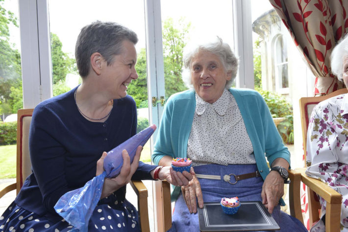 carer with older person making cakes