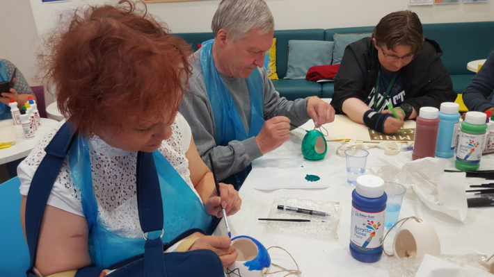 carers painting bird feeders